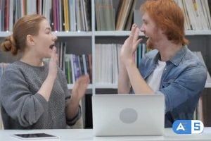 Videohive Excited Man and Woman Reacting to Success at Work In Office 21680253