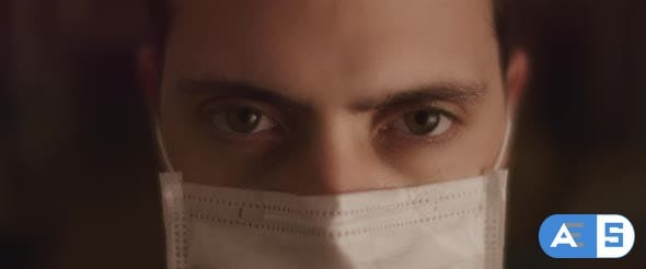 Videohive Extreme Close up Of a Young Man Opening His Eyes While Wearing a Protective Mask 26316003