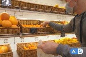 Videohive Man with Medical Face Mask Selects Mandarins in Store. Guy Choose Fruits in Supermarket. Purchase 26163408