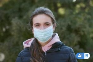 Videohive Attractive Girl Takes on Medical Mask During Coronavirus COVID-19 Epidemic 26181719