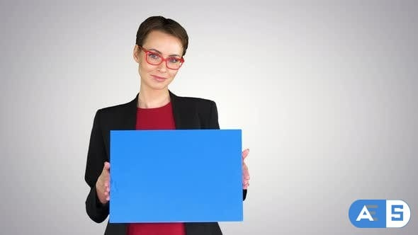 Videohive Businesswoman Holding an Empty Banner on Gradient Background. 26407160