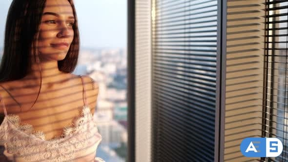 Videohive Girl in Lingery Looking Out the Window 23908199